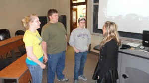 Image of Audrey Kabla talking with students.